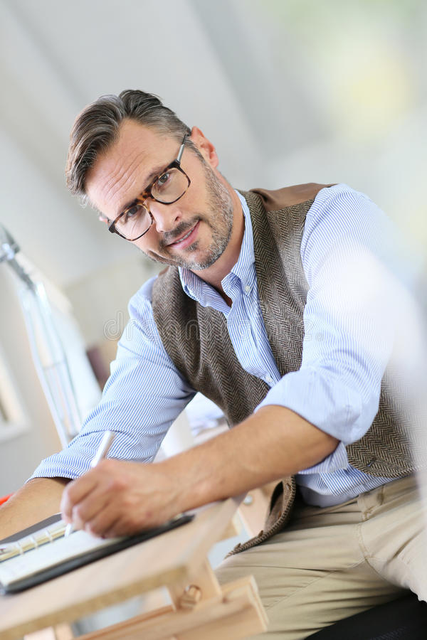 Free Trendy Businessman Writing In Agenda Royalty Free Stock Photography - 63217077