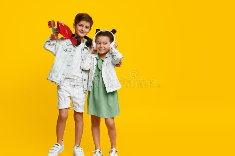 Trendy children listening to music royalty free stock photo