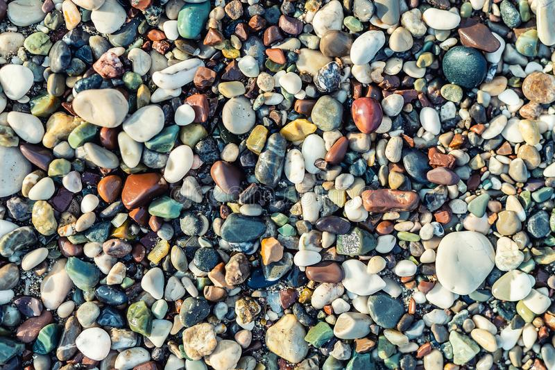 Trendy colorful small sea stone pebble background. Multicolored abstract beach nature pattern. Texture, rock, natural, smooth, decoration, wallpaper, white stock photos