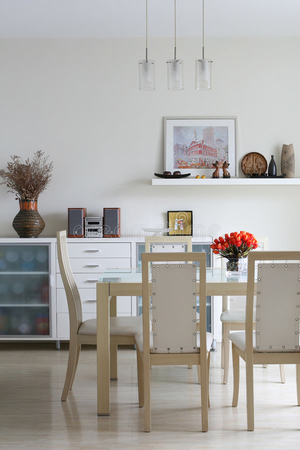 Trendy dining room. A modern and trendy dining room royalty free stock image