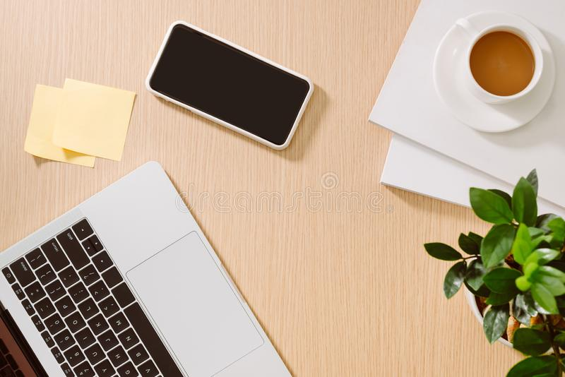 Trendy feminine home office workspace. White office desk. Laptop, coffee cup and phone, notebook, pencil. Flat lay, top view, copy. Space stock photo