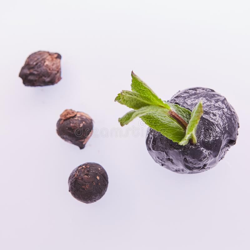 Trendy food. Black ice cream with mint leaves. Copy space. stock photos