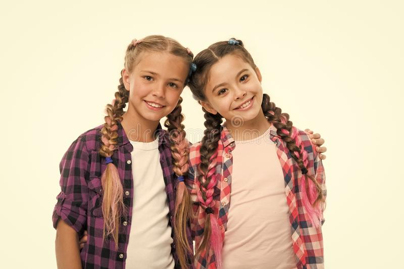 Trendy girls. Dress similar with best friend. Dress to match your friend. Best friend dressing. Friends wear similar. Outfits have same hairstyle braids white stock images