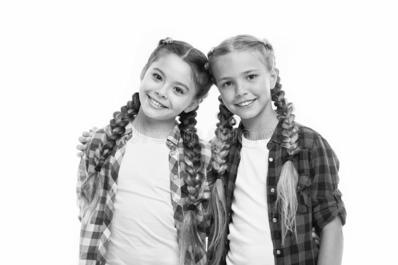 Trendy girls. Dress similar with best friend. Dress to match your friend. Best friend dressing. Friends wear similar. Outfits have same hairstyle braids white stock image