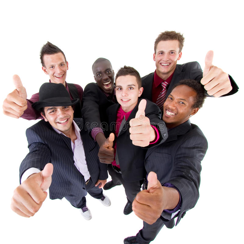 Trendy group of sucessful businessmen. Young interracial group of teenage businessmen giving a thumbs up sign. Fresh trendy models royalty free stock image