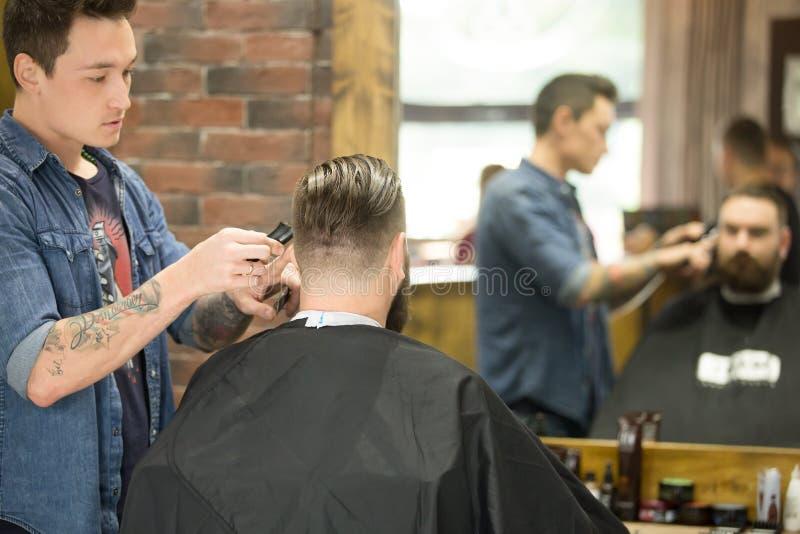 Trendy haircut in barbershop stock photo