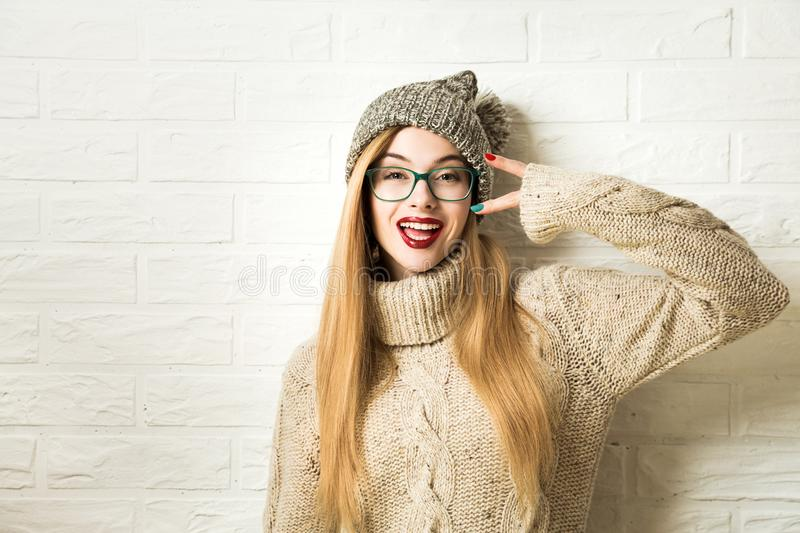 Trendy Hipster Girl in Winter Clothes Going Crazy royalty free stock images
