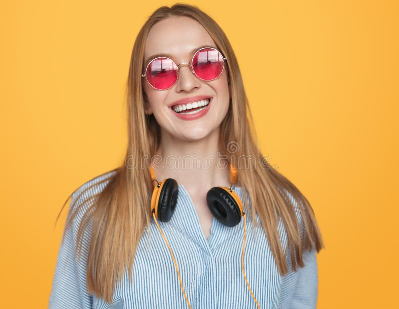Trendy hipster woman in headphones and sunglasses stock photos