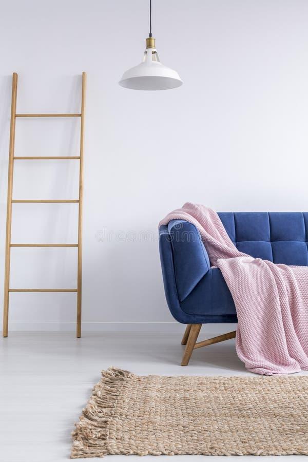 Trendy interior with blue sofa stock photos