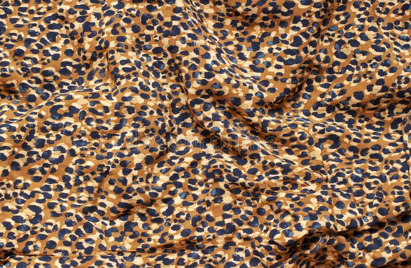 Trendy leopard print fabric with folds. royalty free stock photos
