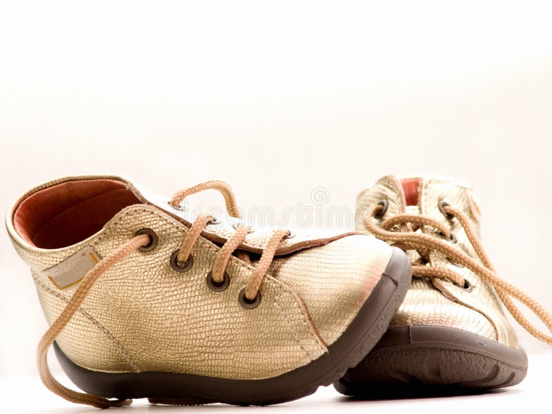 Download Trendy Little Golden Baby Shoes  With Copyspace Stock Image - Image: 7780431
