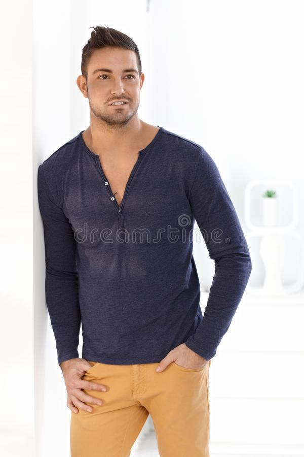 Trendy man standing at home royalty free stock photos