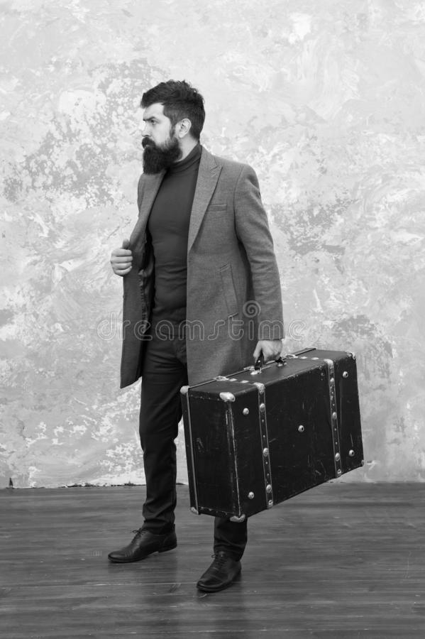 Trendy man with travel suitcase. Vintage trip bagage. Modern life. Male fashion model. Mature businessman with beard. Travelling fot business. Casual style royalty free stock photography