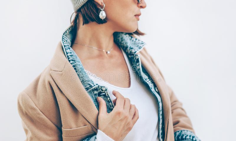 Trendy multilayered warm outfit with cashemire, denime and camel coat stock photography