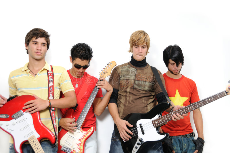 Trendy musicians team. Portrait of young trendy teenager group posing with musical intruments royalty free stock photos