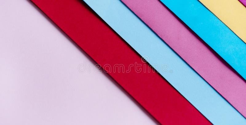 Trendy pastel colors in geometry shape flat lay. Colorful rainbow paper creative linear background. Abstract minimal vivid art design stock image