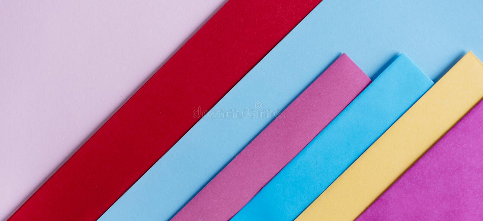 Trendy pastel colors in geometry shape flat lay. Colorful rainbow paper creative linear background. Abstract minimal vivid art design stock photography