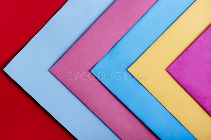 Trendy pastel colors in geometry shape flat lay. Colorful rainbow paper creative linear background. Abstract minimal vivid art design royalty free stock images