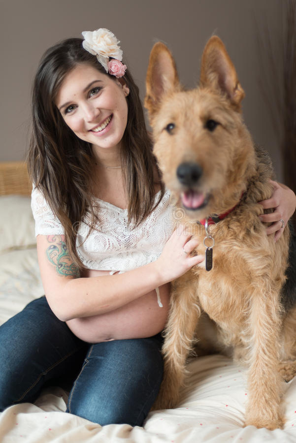 Trendy Pregnant Woman With Her Pet Dog Stock Image - Image ...