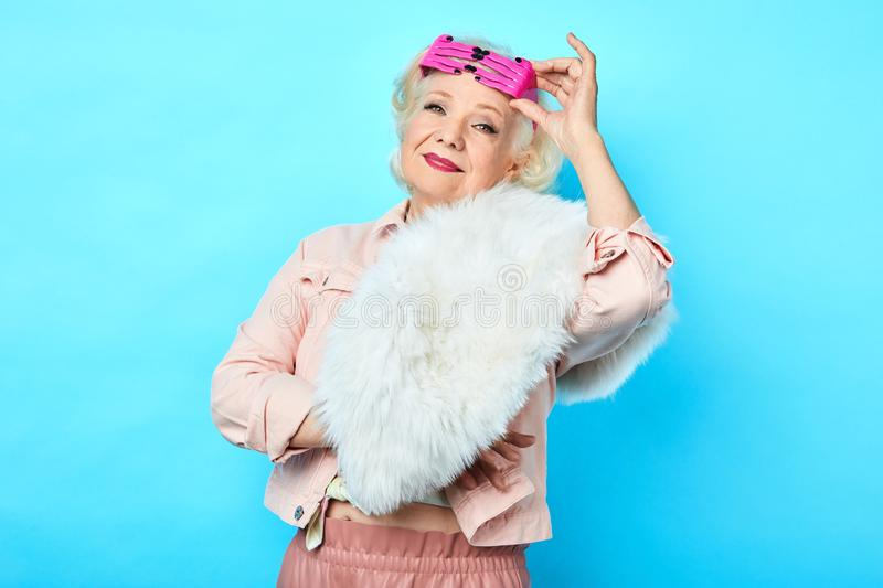 Trendy pretty senior lady in fashionable clothes royalty free stock photo