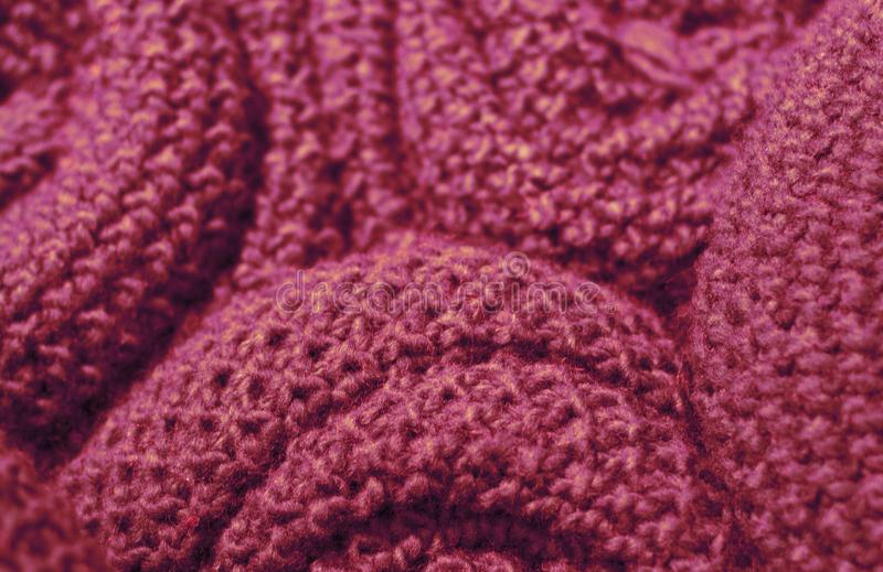 Trendy Red Pear color woolen knitted fabric close-up, texture, background royalty free stock photos