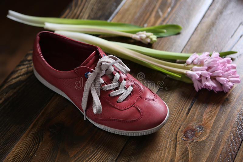 Trendy red sport shoes stock images