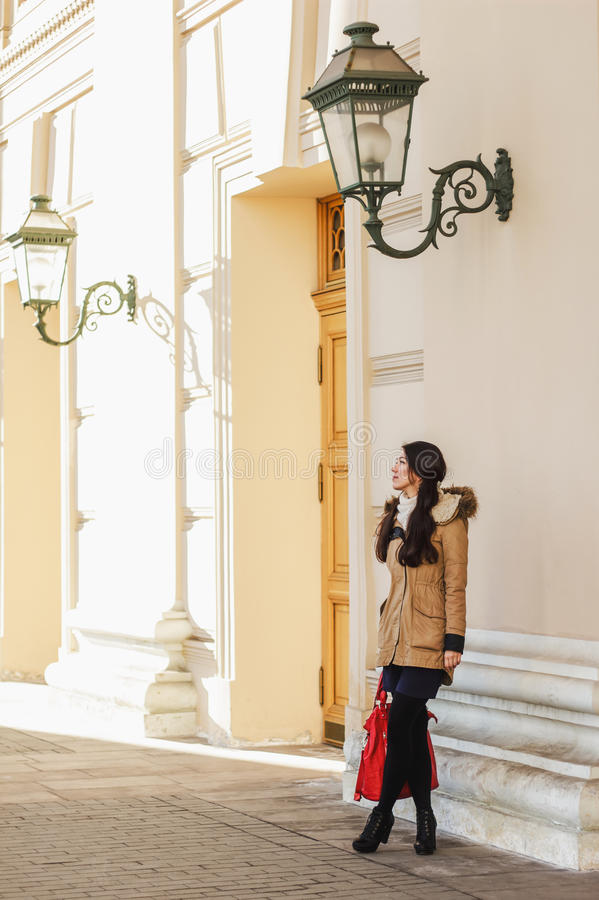 Trendy romantic portrait of beautiful woman on background of the old city architecture royalty free stock image