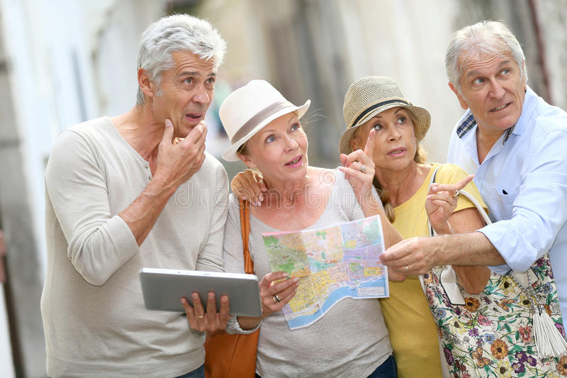Trendy senior people travelling and visiting monuments royalty free stock photography