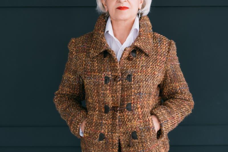 Trendy senior wardrobe female style elegance tweed stock photos