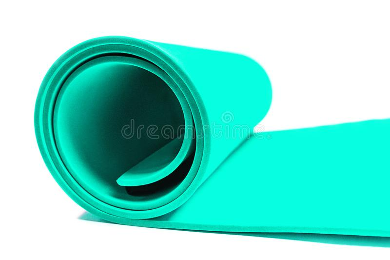 Trendy sport concept with mat for fitness yoga, pilates on white. royalty free stock photo