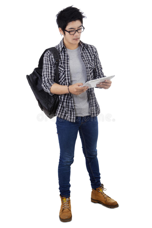 Trendy student holding digital tablet stock photography