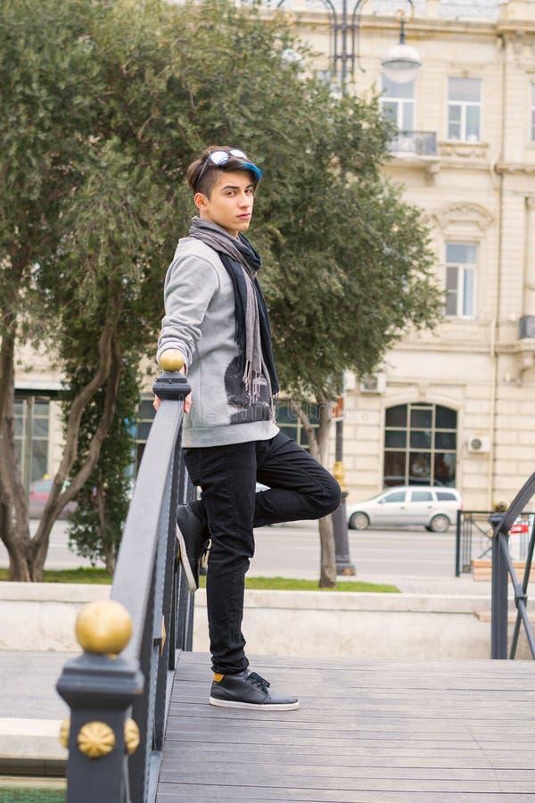 Trendy teen boy outdoors stock photos