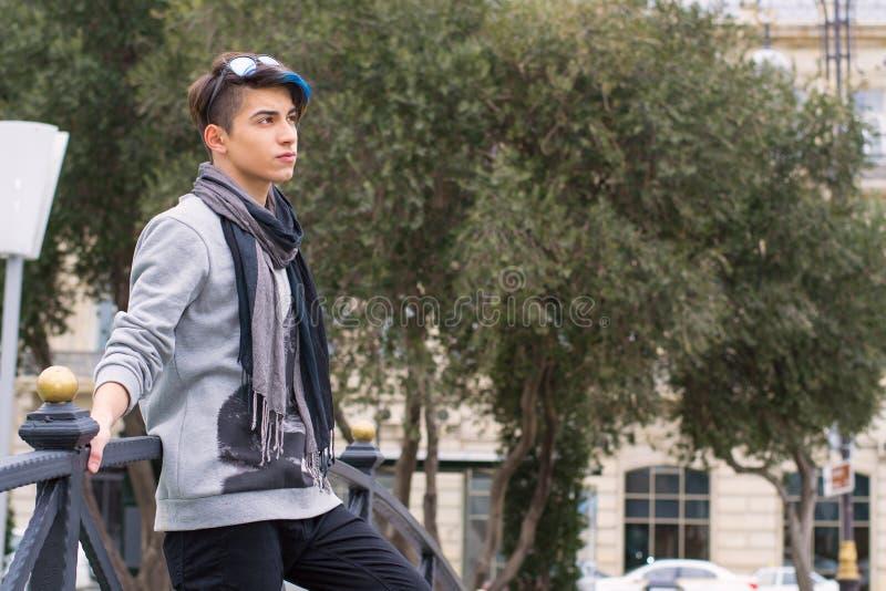 Trendy teen boy outdoors stock photography