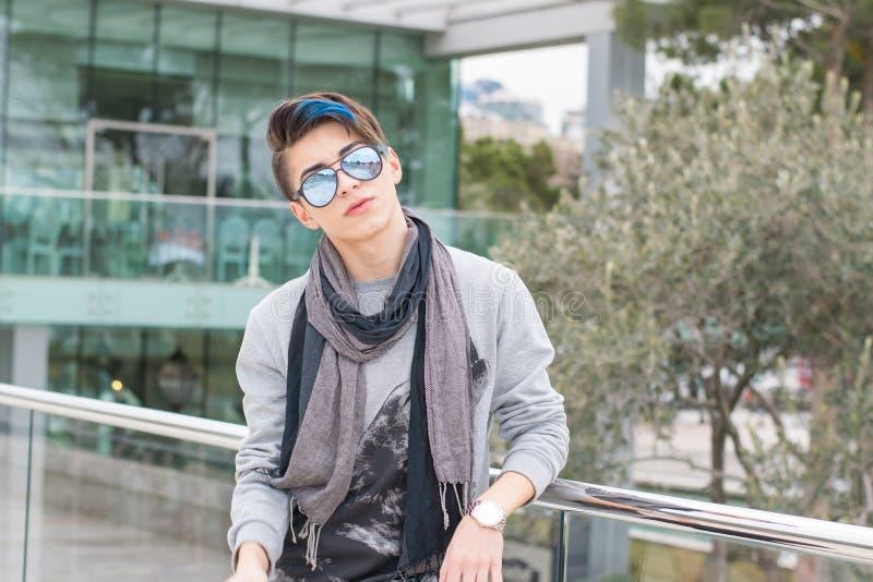 Trendy teen boy outdoors stock image
