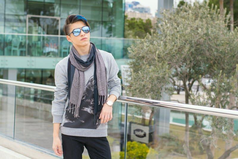 Trendy teen boy outdoors royalty free stock image