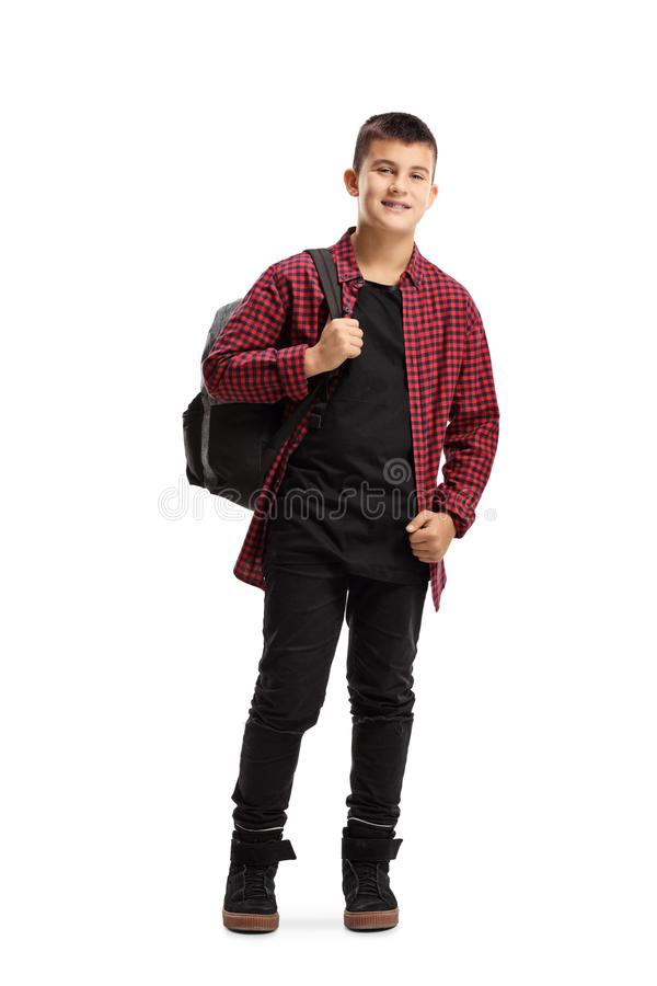 Trendy teenage boy with a backpack smiling at the camera stock images