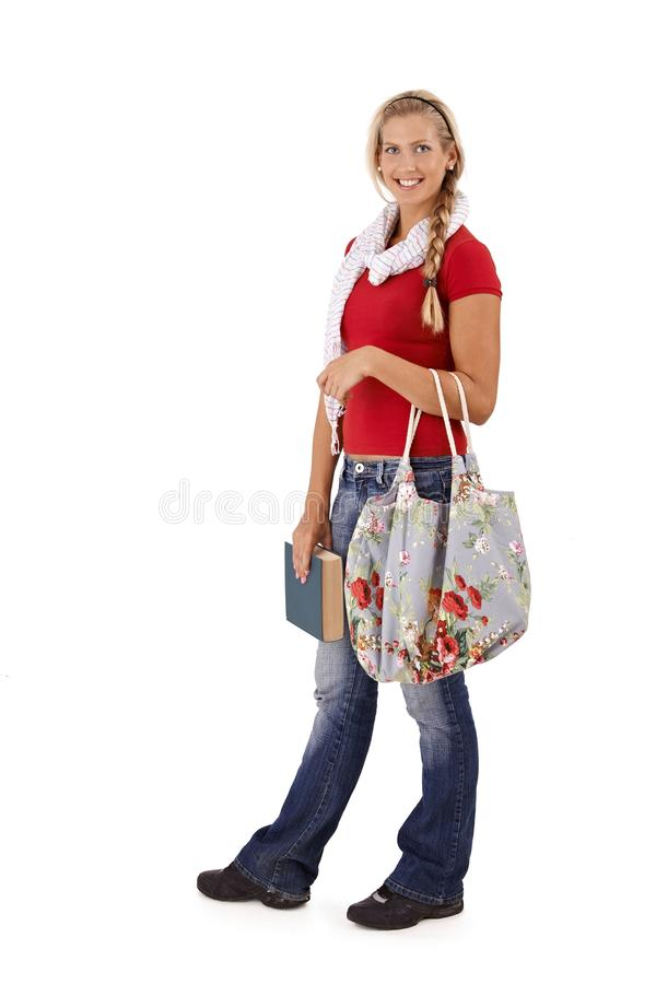 Trendy university student smiling royalty free stock photo