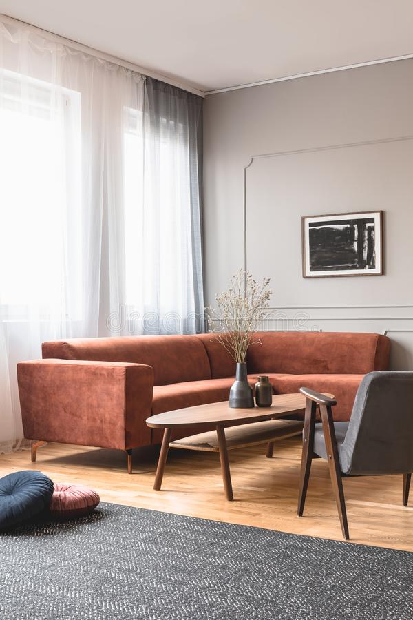 Trendy vintage armchair in stylish scandinavian living room interior with grey wall. Trendy vintage armchair in stylish scandinavian living room interior with royalty free stock photo