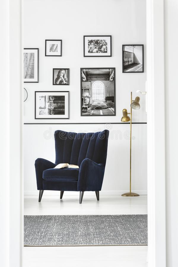 Trendy wing back chair in fancy bedroom interior with elegant furniture stock images