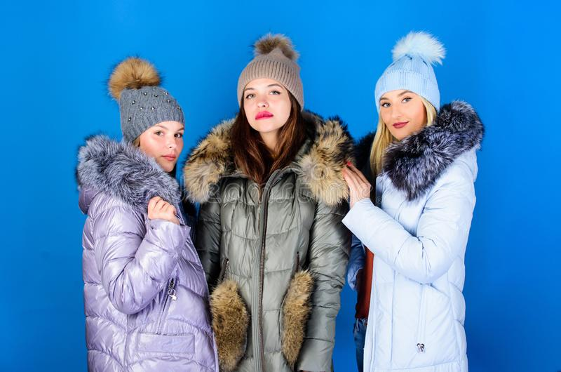 Trendy winter coat. girls in beanie. flu and cold. seasonal shopping. winter clothing fashion. faux fur down jacket. Happy winter holidays. Friendship. women royalty free stock photography