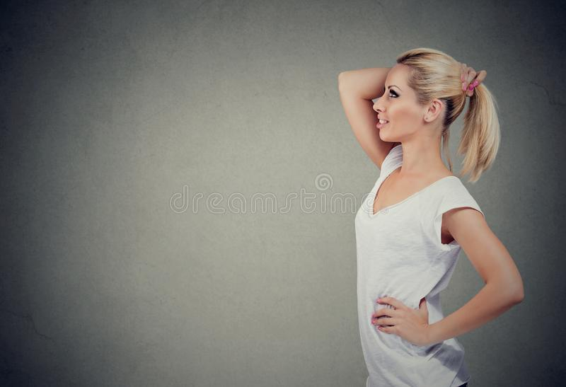 Trendy woman with ponytail making decision stock image