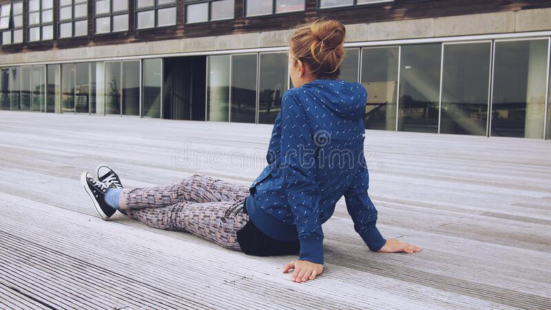 Trendy woman relaxing on decking stock images