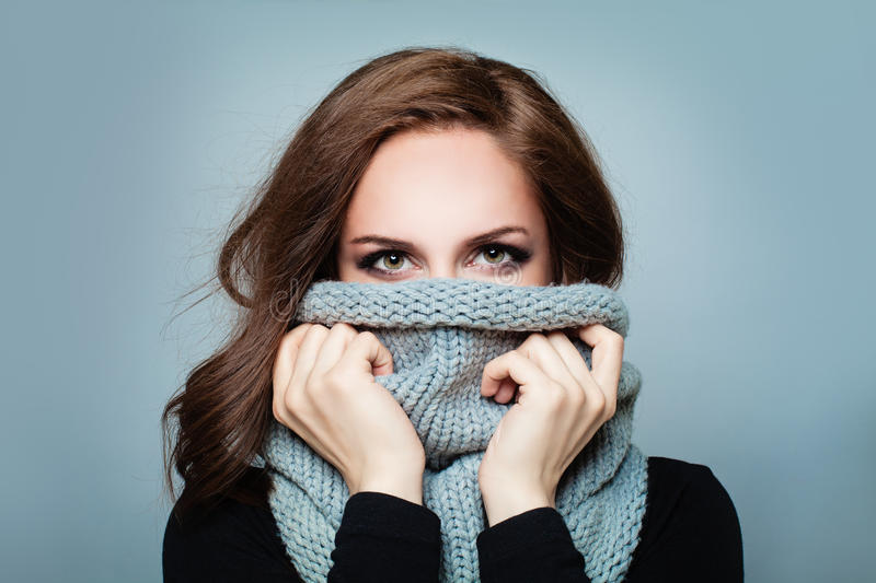 Trendy Woman in Wool Winter Scarf. Beauty Winter Girl. Fashion Model in Knitted Woolen Cloth royalty free stock photography
