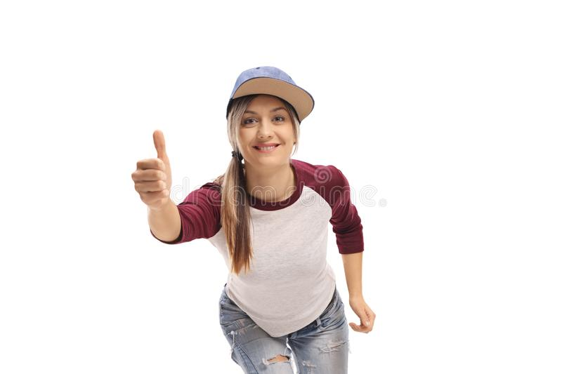 Trendy young girl making a thumb up gesture royalty free stock photography
