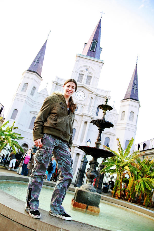 Trendy Young Girl In New Orleans. A fresh faced young girl with a flirty smile exploring New Orleans, LA, USA royalty free stock images