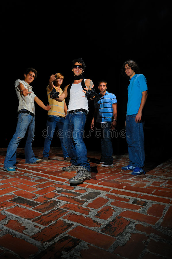 Trendy young group. Portrait of young trendy team of male friends with attitude royalty free stock image