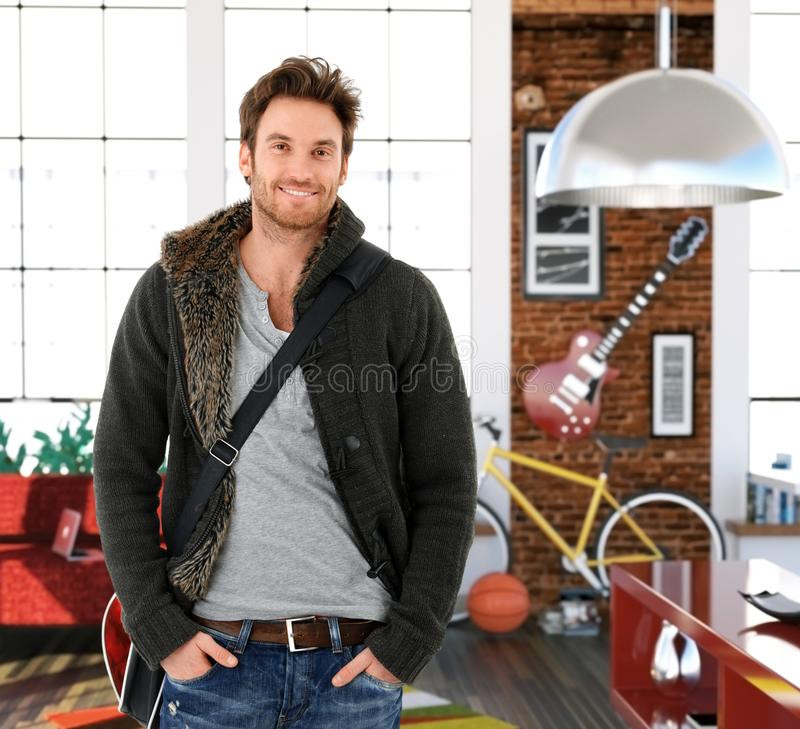 Trendy young man at home royalty free stock image