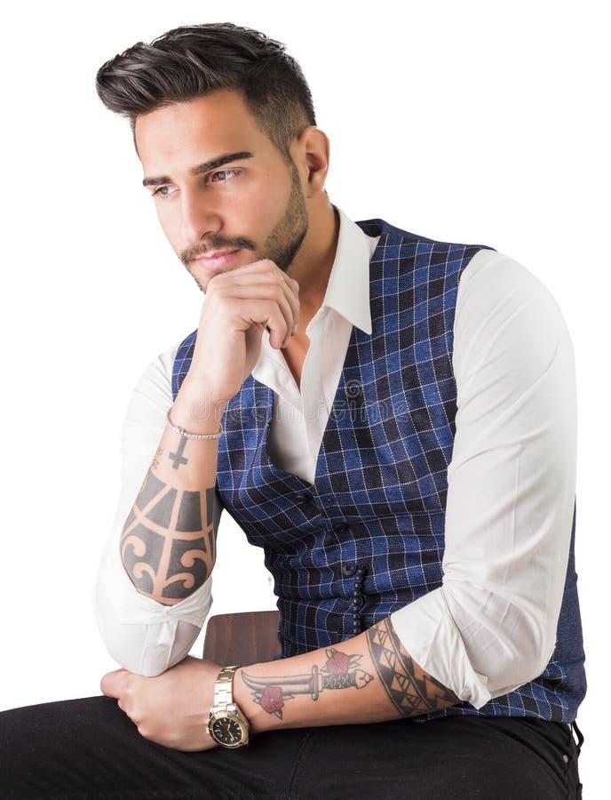 Trendy young man in studio shot wearing elegant vest stock photo