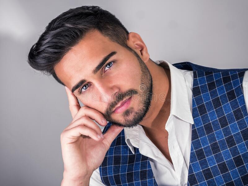 Trendy young man in studio shot wearing elegant vest stock photos