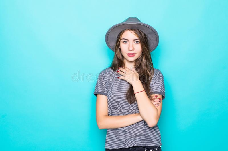 Trendy young woman wearing casual clothes posing over green background. Trendy young woman wearing casual clothes posing over green stock photos